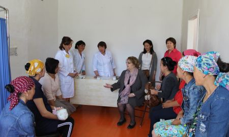 During visit to a health outpost in Jan-Bulak Village, Ambassador Gwaltney joins a birth preparedness class with expectant mothers from the community.