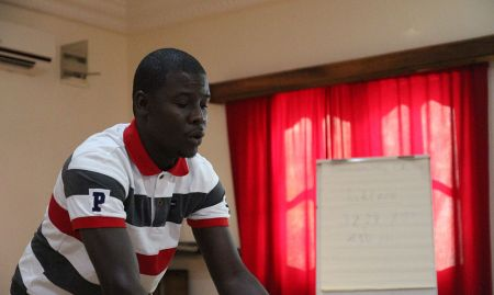 SPRING consultant Ahmed Massamba Thiam trains participants to use video editing software Adobe Premiere Pro.