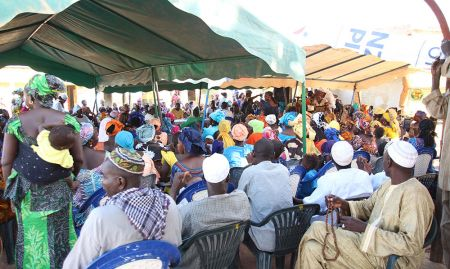 Crowds gather in Dinguiraye Communes for the Malaria Day events.