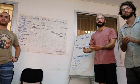 Peace Corps volunteers Alex, Lowell, and Eric, present their work identifying challenges and opportunities to nutrition throughout the year in the Fouta area of Guinea.