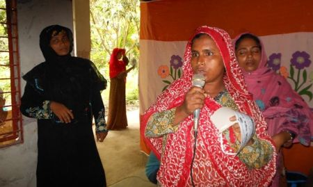 A woman shares her story at an event during World Breastfeeding Week in Bangladesh