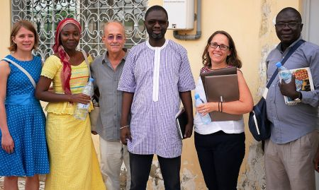"""SPRING's Kate Litvin, Mariam Sy, and Bob de Wolfe pose with Alioune Badara Fall of the regional governmental agency """"Cellule de lutte contre la malnutrition"""" (Unit of the Fight Against Malnutrition), along with Megan Kyles of USAID."""