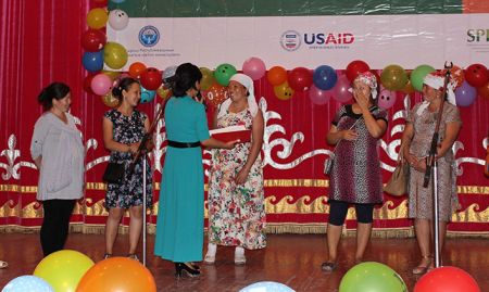 Selected audience members participating in a quiz on breastfeeding