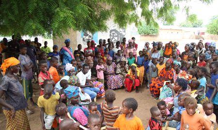 Dynaset-setal members speak during a village gathering to remind community members of key hygiene messages.