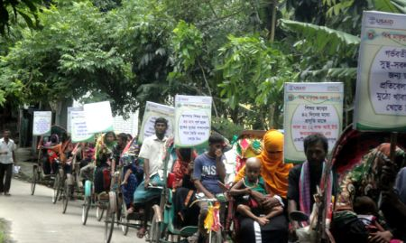 The Charkalmi Union of Charfession of Bhola District host a rickshaw rally during Bangladesh's 2014 celebrations.