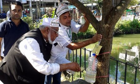 Former Minister and Current Member of Parliament Dr. Mojammel Hossain using a tippy tap