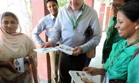 SPRING team members review Sisimpur drawings