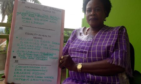 """""""For IWD '16, I pledge to promote the health and nutrition status of all adolescent girls, women and children. Equality in health means: access to good health services for all, regardless the gender, sex, and age; availability and access to affordable nutritious food for the Ugandan women, men, and children. Conservation of our environment; observe hygiene; access safe, clean water; improve sanitation"""""""