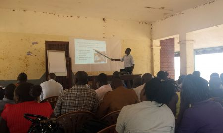 Kizito Ndegeya, the Namutumba District nutrition focal person, presents on the nutrition situation in Namutumba, at the district review meeting on March 3, 2016.