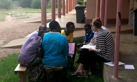 Belinda Richardson of UC Davis, SPRING costing consultant, interviews health workers in Nsinze sub-county about the costs related with MNP distribution.