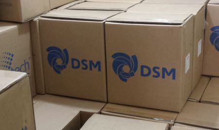 Boxes of packaged micronutrient powders (MNPs) are stored at the SPRING office warehouses before being distributed.