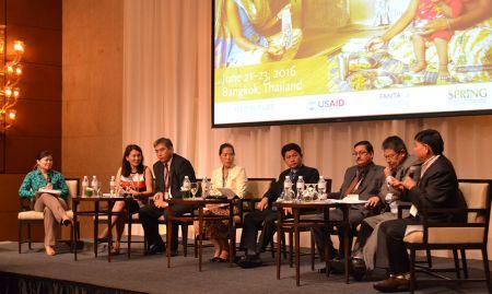Elaine Gray moderates a panel of regional government representatives including Nazgul Abazbekova, Amangeldy Murzaliev, Bounthom Phengdy, Sok Silo, Yogendra Kumar Karki, Geeta Bhakta Joshi, and Giriraj Subedi.