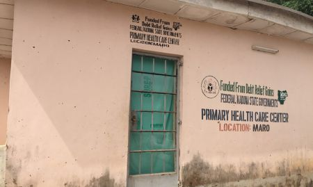 A Primary Healthcare Center in Maro ward, Kajuru LGA, Nigeria. The facility was closed when we arrived, but we were able to tour the inside, which is where Community Volunteers from this ward were trained. We found C-IYCF counseling cards on the health workers desk - evidence that health workers, like Community Volunteers, are using the cards and promoting optimal IYCF practices such as dietary diversity.