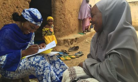 SPRING's Study Coordinator, Ms. Susan Adeyemi, interviews Mrs. Jamila Garba, a C-IYCF Community Volunteer in Kasuwan Magani ward in Kajuru LGA.