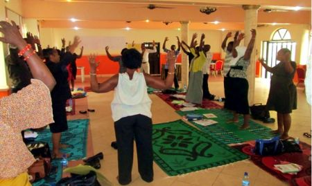Participants taking part in an energizer exercise
