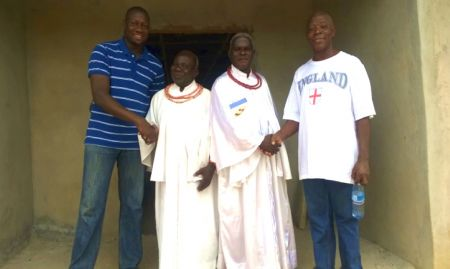 SPRING Country Manager and Nutrition Coordinator with Ebo community leaders in Edo