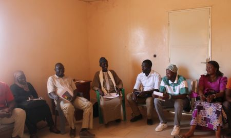The SPRING/Senegal team holds a discussion with the staff of Kaffrine FM, one of SPRING's community radio partners in the region.