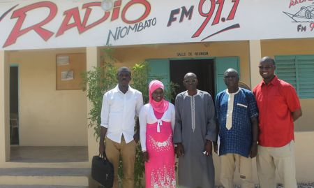 The SPRING/Senegal team poses in front of Radio Niombata in Toubakouta.