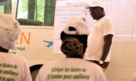 Aliou Babou of SPRING/Senegal helps participants understand the financial aspects of the operation and maintenance of the transformation units.