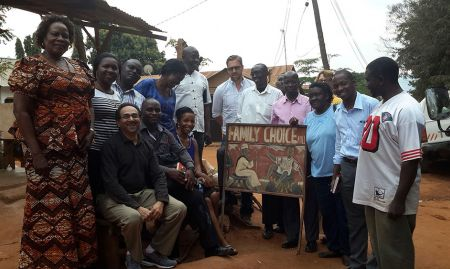 Participants pose for a group picture outside the Family Choice Maize Mill