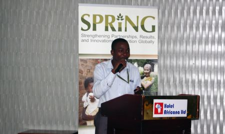 SPRING staff member Mike Mazinga presents on the current status of maize milling in Uganda.