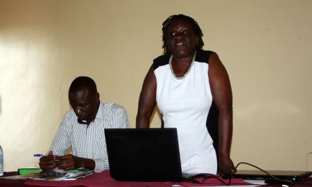 Senior Nutritionist with the MOH, Sarah Ngalombi, opens the dissemination meeting with the Regional Nutritionist for Jinja General Referral Hospital, Toko Mansur.