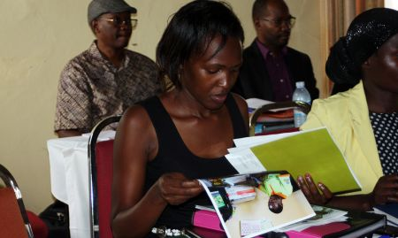 Goretti Kyebajia, a health facility staff member from Namutumba district, reviews the MNP materials.