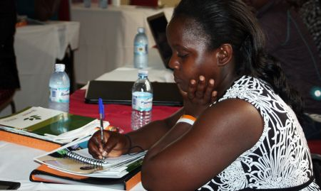 Antonia Kiro, an intern at the MOH, takes notes during the MNP dissemination meeting.