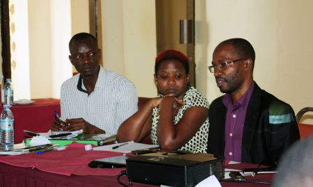 Toko Mansur and SPRING staff members Rose Nakiwala and Francis Ssebiryo participate in a panel discussion.