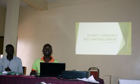 Siminyo Sabiti from Namutumba district (Magadi HC III) giving a presentation on implementation after the end of the SPRING pilot.