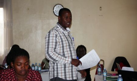 Martin Bulamu, Monitoring and Evaluation Officer at the Ministry of Health, giving a presentation.