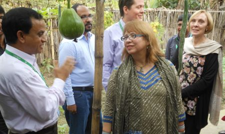 USAID/Bangladesh Mission Director, Janina Jaruzelski, speaking with SPRING Khulna Division Manager, Nazmul Huda, about homstead food production