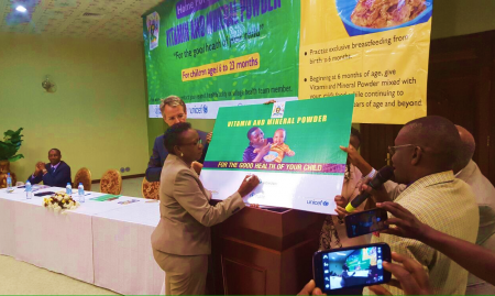 Dr. Jane Acheng unveils the Vitamin and Mineral Powder Program in Uganda (Photo credit: Abel Muzoora).