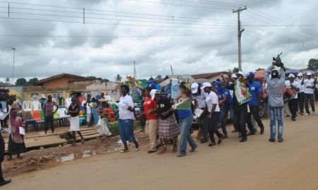 Participants dance and disseminate infant and young child flyers at Kuje Market, in Nigeria in 2014.