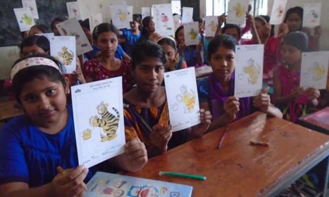 Children showing off their coloring for World Handwashing Day