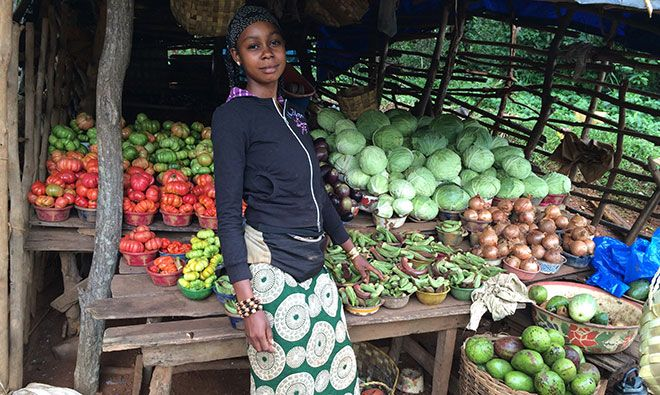 Market vegetable seller with her wares