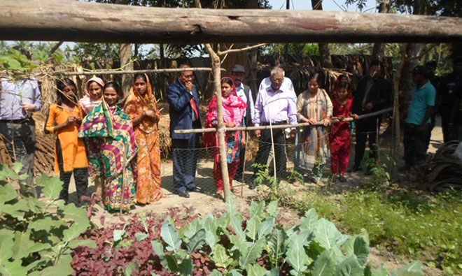 The delegation views a community garden