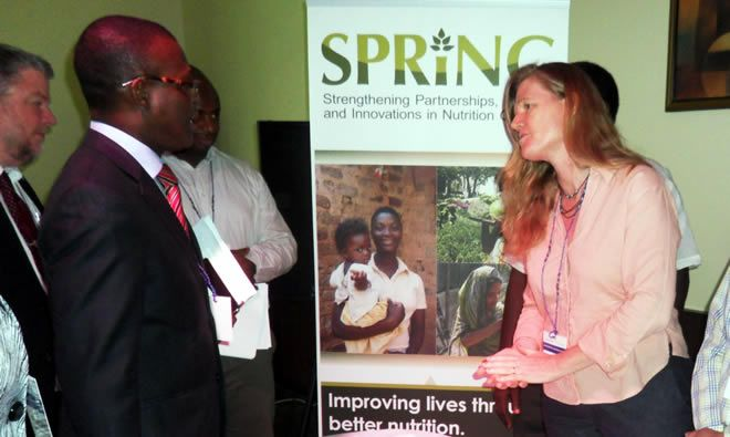 In suite is Minister of Agriculture (Fiifi Kwettey) interacting with Fiona Edwards her team about SPRING/Ghana