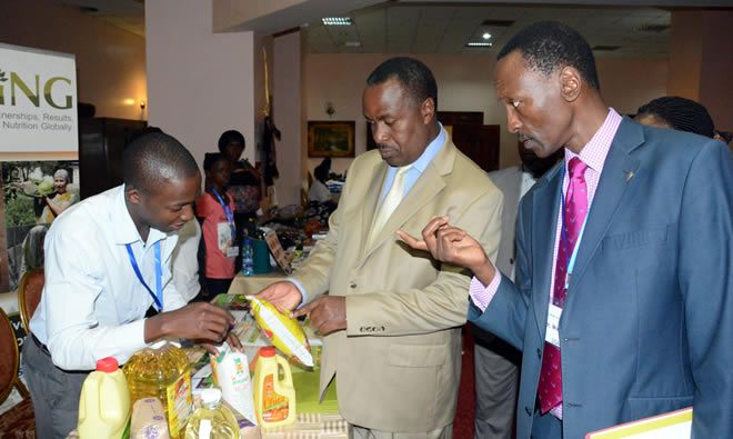 Minister of Health Dr. Elioda Tumwesigye visits the SPRING exhibit