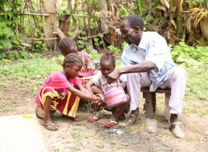 A family handwashing in Ghana