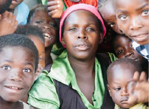 Woman and children smiling at camera