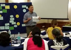 Victor Pinga, SPRING Agriculture Advisor, and Ashley Aakesson, SPRING SBCC Advisor, feature the SPRING linking agriculture-to-nutrition pathways as they lead an interactive session to orient partners on nutrition-sensitive agriculture.