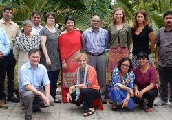 Partner members from LSHTM, DG, VARRAT, Ekjut, DCOR, and SPRING, pose for a photo together.