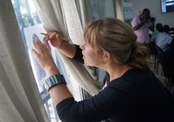 Peace Corps Volunteer Kate Hendrickson demonstrates another effective way to trace: using a bright window!