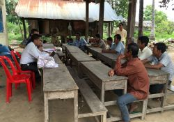 Male farmers meet during a focus group discussion in Cambodia.