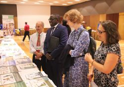 SPRING/Senegal Chief of Party, Bob de Wolfe, USAID Senegal Mission director, Lisa Franchett, national coordinator of the Unit for the Fight against Malnutrition, Abdoulaye Ka, and USAID Senegal Agriculture/Nutrition Specialist, Megan Kyles, learn more about SPRING's implementation at one of the stands.