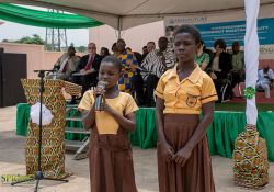 School pupils reciting a poem on the effects of malnutrition on children.