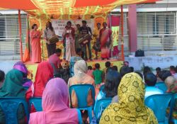 Crowd watching drama and song on a stage