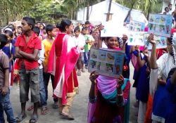 Crowd holding handwashing guide posters