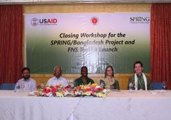 Deputy Program Manager of Community Based Health Care, Dr. Jahangir Rashid; Line Director of the National Nutrition Services, Dr. A.B.M. Muzharul Islam; Dr. Altrena Mukuria, Director of Country Initiatives for SPRING; Ms. Miranda Beckman, Acting Director of the Office of Population, Health, Education and Nutrition for USAID/Bangladesh; and the Chief of Party for SPRING/Bangladesh, Mr. Aaron Hawkins, sit on the dais after giving closing remarks at the closing workshop.